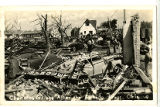Group of men examining the destruction of the Chevrolet Garage after the April 27, 1942 tornado in...